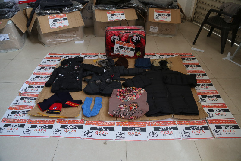 Distributions include warm clothes for both males and females' as well as adults and children