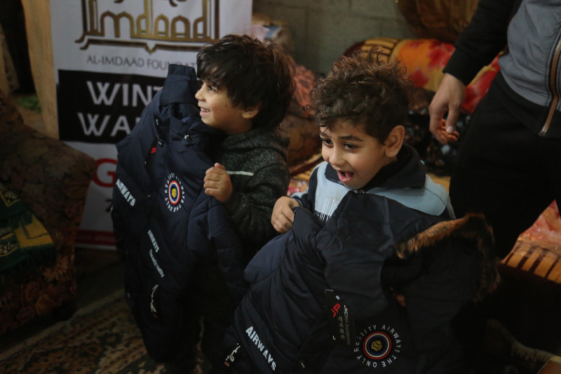 Excited by their new set of jackets, these young boys are