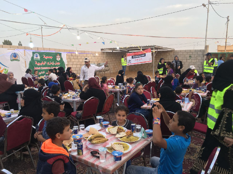 Young refugees excited by the prospect of a hearty meal at one of Al-Imdaad Foundation Jordan's daily iftaar feedings