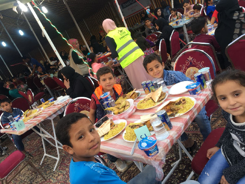 Refugees treated to a wholesome iftaar meal at the close of a long day of fasting