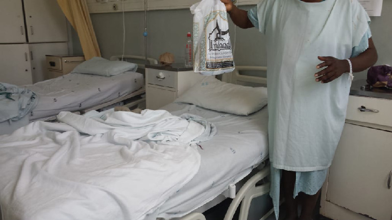 A cataract patient receives a snack pack from the Al-Imdaad Foundation team during the cataract eye surgery programme at McCord Hospital in Durban
